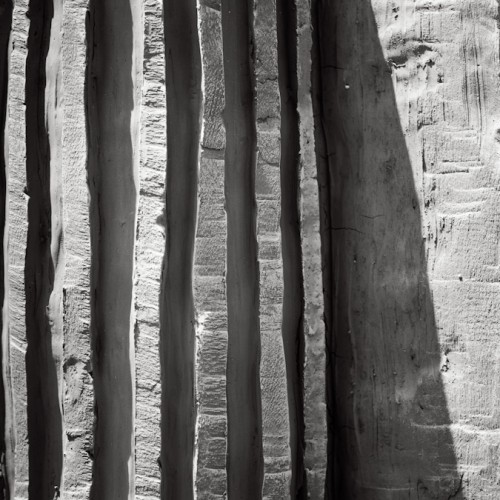 Fall: Black and white photograph of vertical grooves shaped in clay; BELEF, 2013, Belgrade, Serbia.